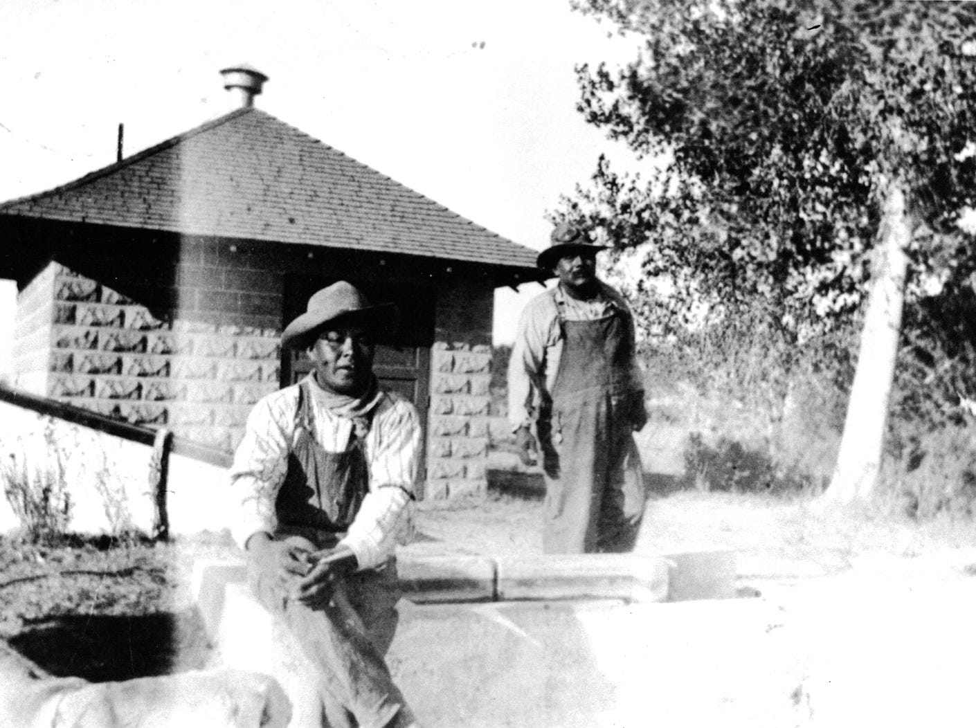 Members of the Augustine tribe stand in front of a pump house on the reservation in Coachella in this undated photo.