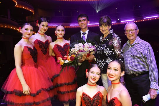 Grand Prize Award and Audience Favorite Award Winner Saigo Iniguez with Opal Circle Sponsors Charles and Nancy Nevil, and Finalists Hartin Dance Company performers in their festive red dresses