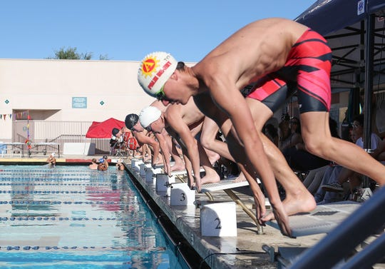 Swimmers compete in the boys 500 freestyle event during the Desert Empire League swimming championship at La Quinta High School, April 25, 2019.