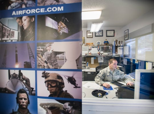 Sgt. Carlos Morales works at the Air Force recruitment office in Pensacola on Monday, April 22, 2019.
