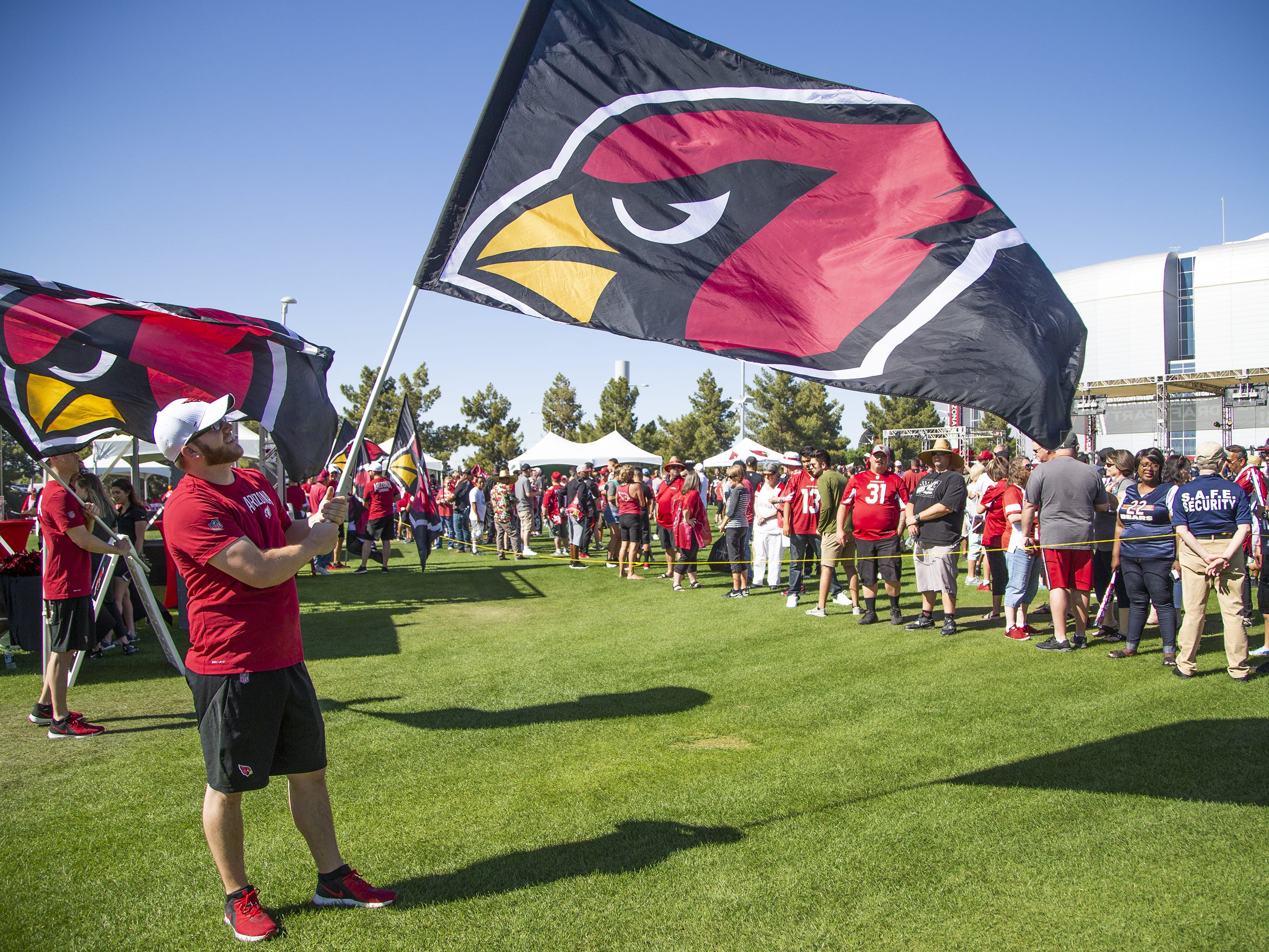 Arizona Cardinals fans arrive at the NFL Draft party on the Great Lawn outside State Farm Stadium, Thursday, April 25, 2019.