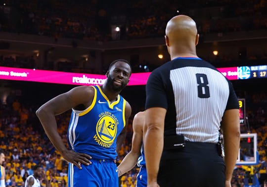 Warriors forward Draymond Green  speaks with referee Marc Davis after being called for a foul during Game 5 of a playoff series against the Clippers.