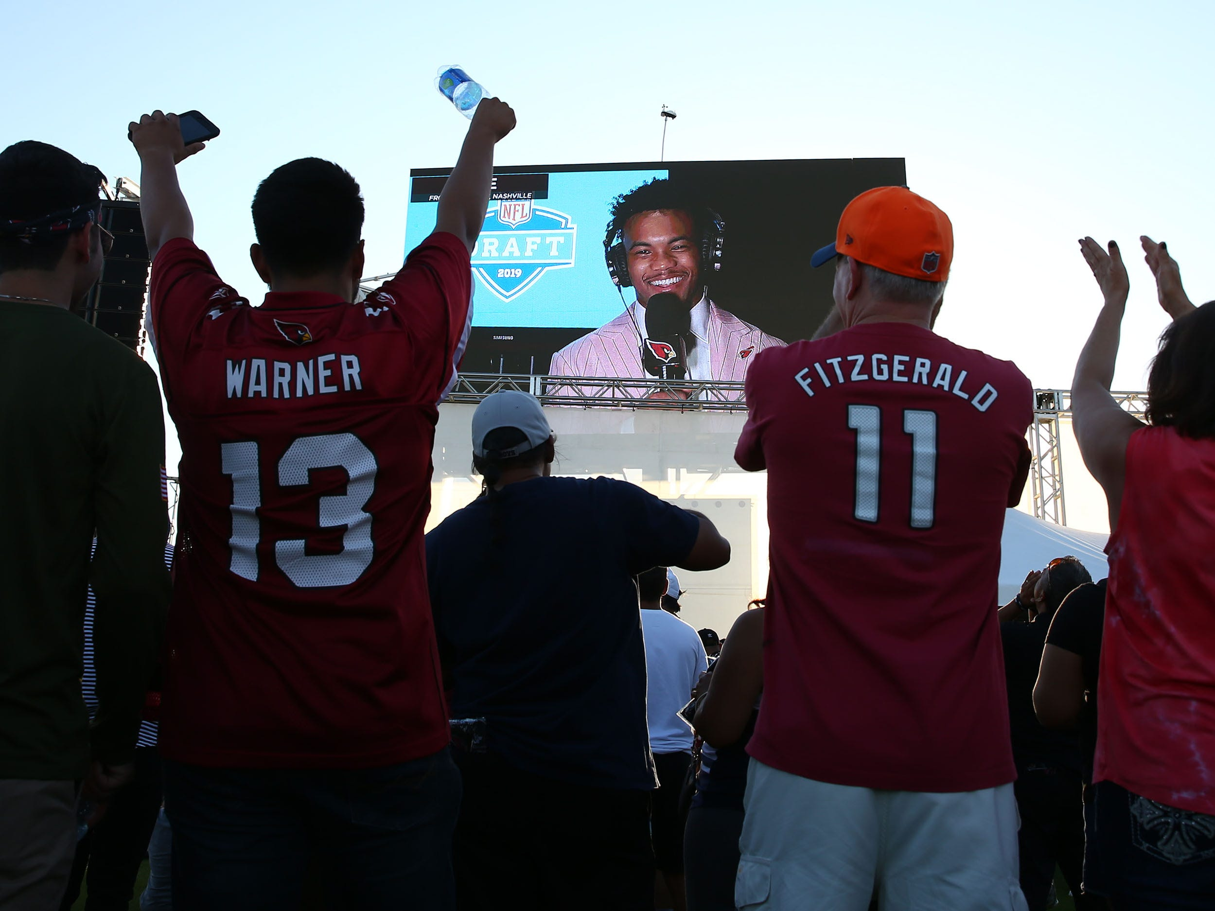 Arizona Cardinals number one draft pick quarterback Kyler Murray from Oklahoma talks to the fans on the Great lawn during the NFL Draft watch party at State Farm Stadium on Apr. 25, 2019 in Glendale, Ariz.