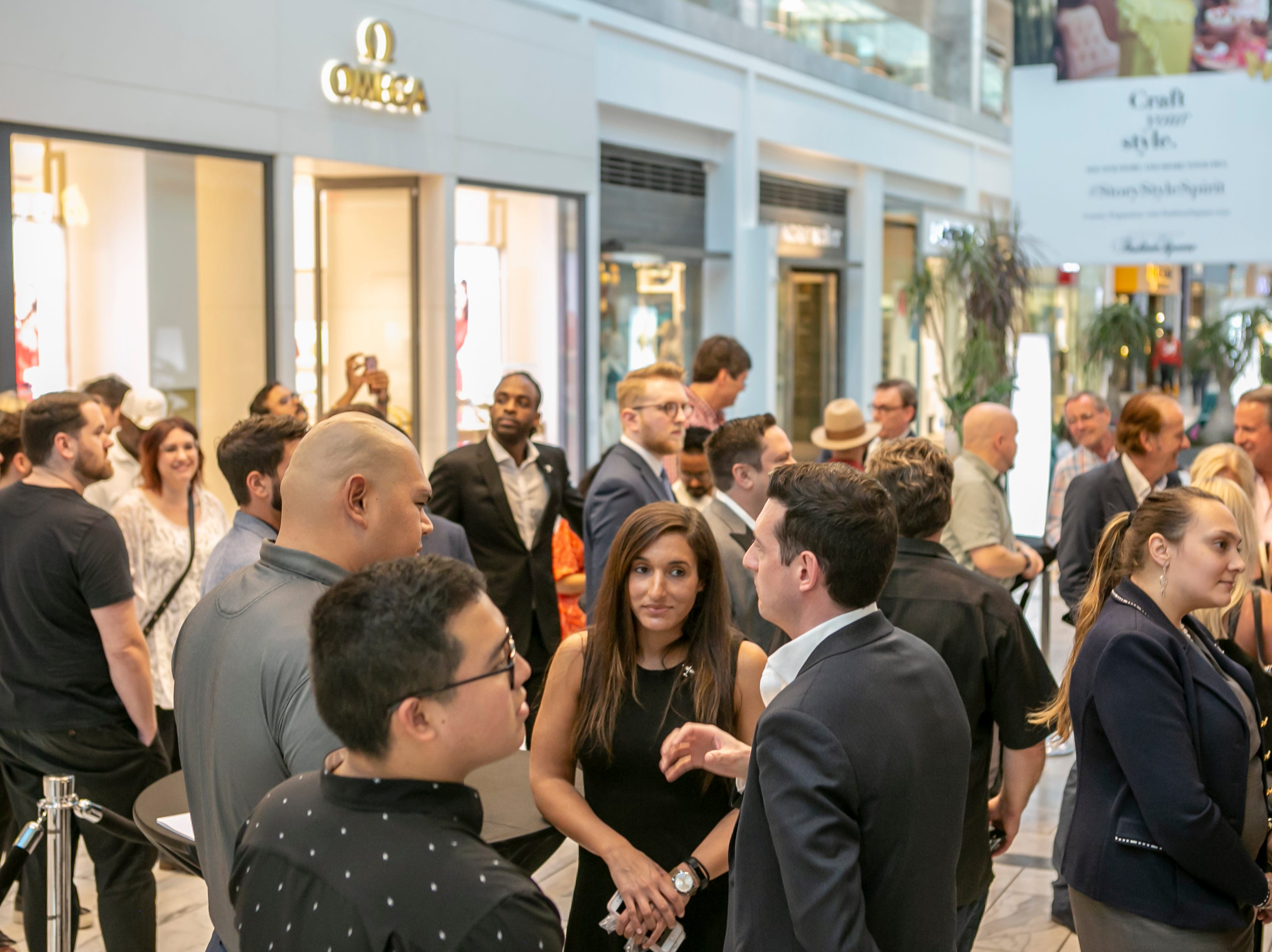 Guests arrive at IWC Schaffhausen's launch party for the Spitfire collection at the Scottsdale Fashion Square, Thursday, April 25, 2019.