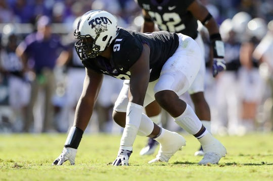 TCU defensive tackle L.J. Collier warms up before a game against West Virginia at Amon G. Carter Stadium.