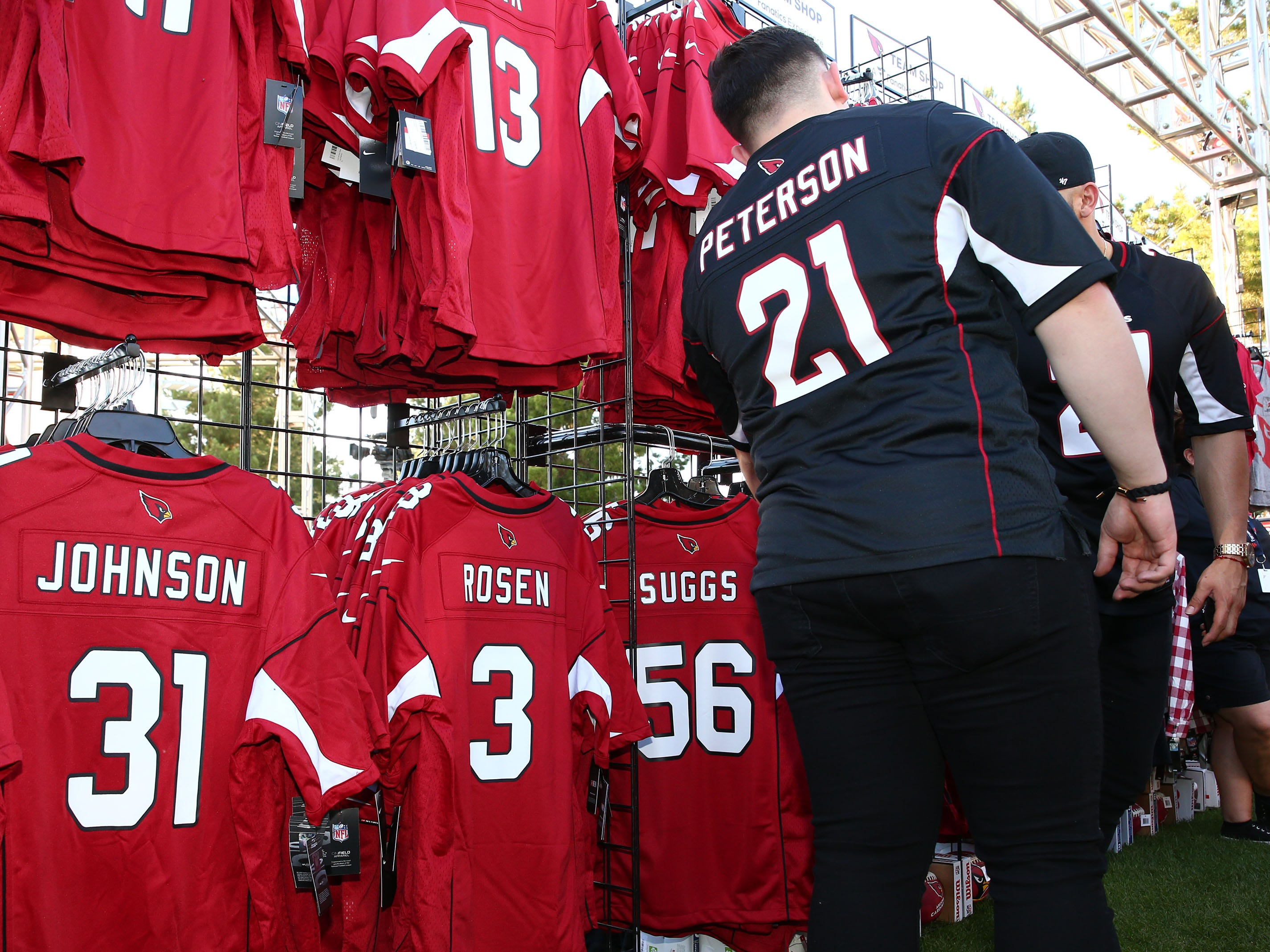 Arizona Cardinals quarterback Josh Rosen jerseys for sell during the NFL Draft watch party at State Farm Stadium on Apr. 25, 2019 in Glendale, Ariz.