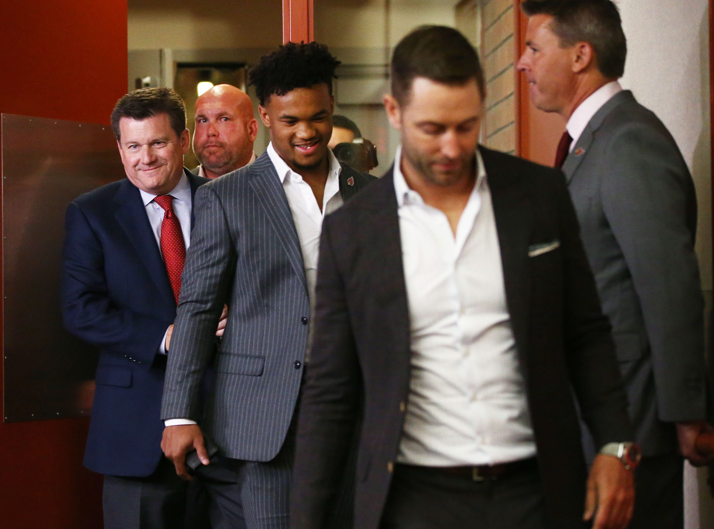 Kyler Murray arrives for his introductory news conference with coach Kliff Kingsbury and Cardinals President Michael Bidwill, left, on April 26.