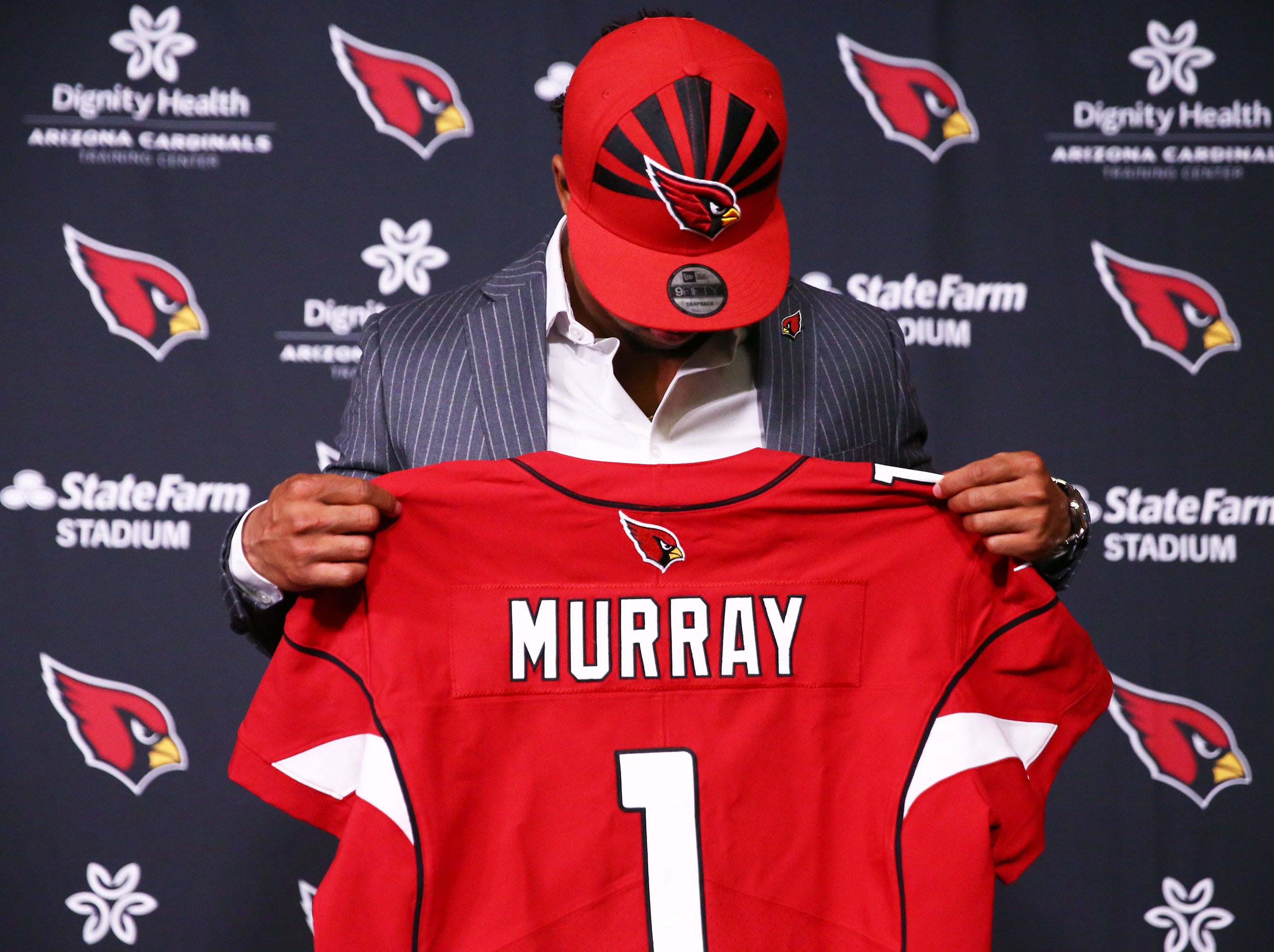 Cardinals first-round draft pick quarterback Kyler Murray looks at his jersey during an introductory news  conference on April 26.