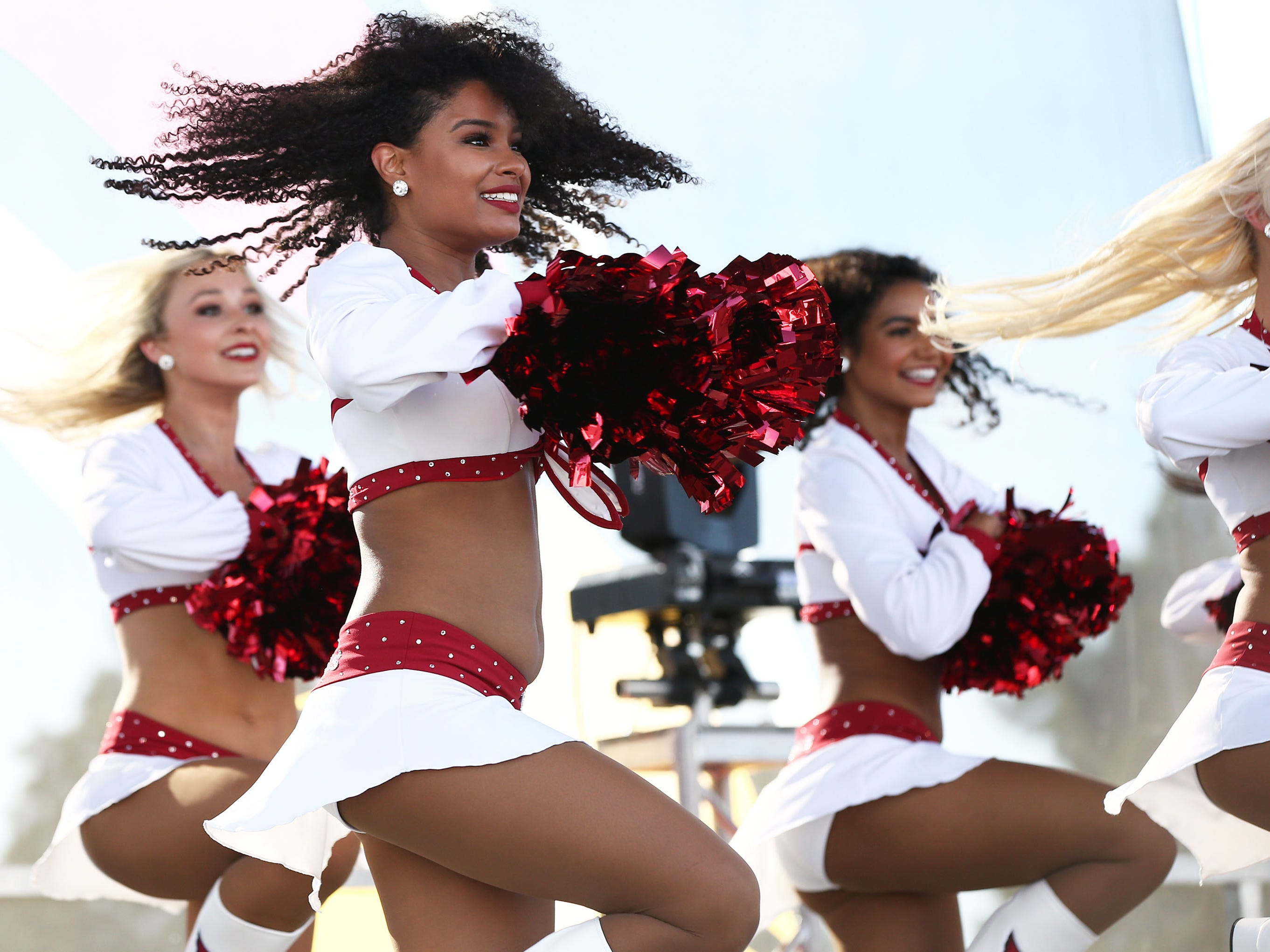 The Arizona Cardinals cheerleaders perform during the NFL Draft watch party at State Farm Stadium on Apr. 25, 2019 in Glendale, Ariz.