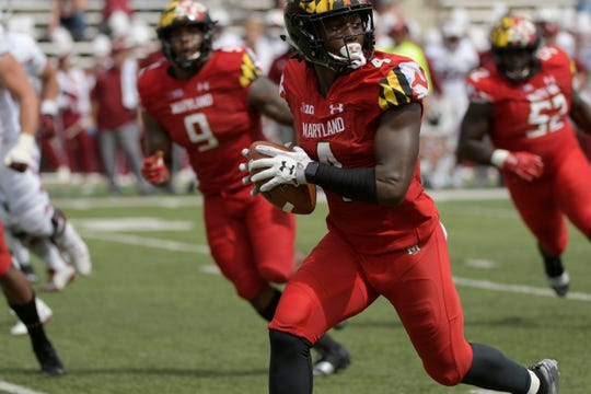Sep 15, 2018; College Park, MD, USA; Maryland Terrapins defensive back Darnell Savage Jr. (4) returns an interception against Temple at Capital One Field at Maryland Stadium.  Savage Jr. is selected as the number twenty one overall pick to the Green Bay Packers in the first round of the 2019 NFL Draft in Downtown Nashville.