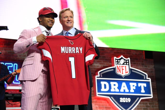 """Kyler Murray poses with NFL Commissioner Roger Goodell after being selected by the Cardinals with the No. 1 overall pick.&nbsp;<strong>&nbsp;