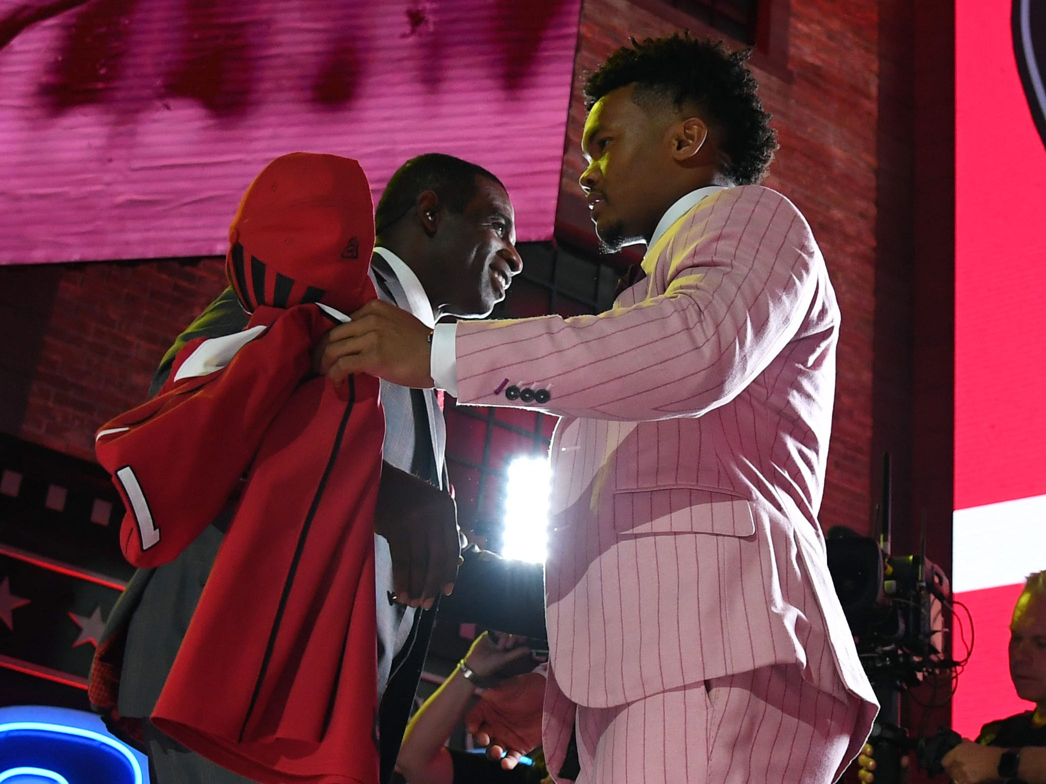 Apr 25, 2019; Nashville, TN, USA; Kyler Murray (Oklahoma) hugs Deion Sanders after he is selected as the number one overall pick to the Arizona Cardinals in the first round of the 2019 NFL Draft in Downtown Nashville.