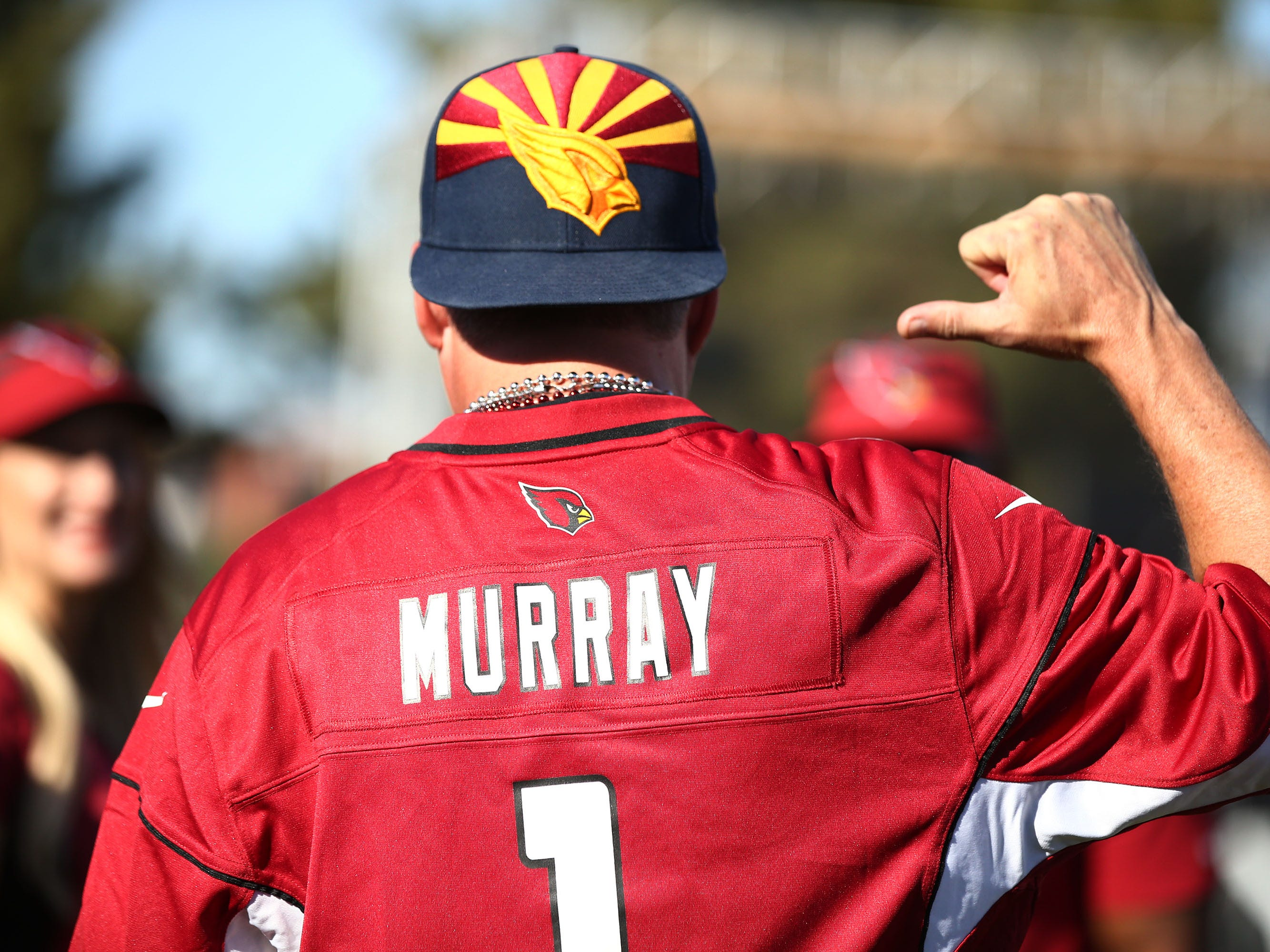 Eric Polansky of Cave Creek, Ariz., wears a Murray #1 jersey during the NFL Draft watch party at State Farm Stadium on Apr. 25, 2019 in Glendale, Ariz.