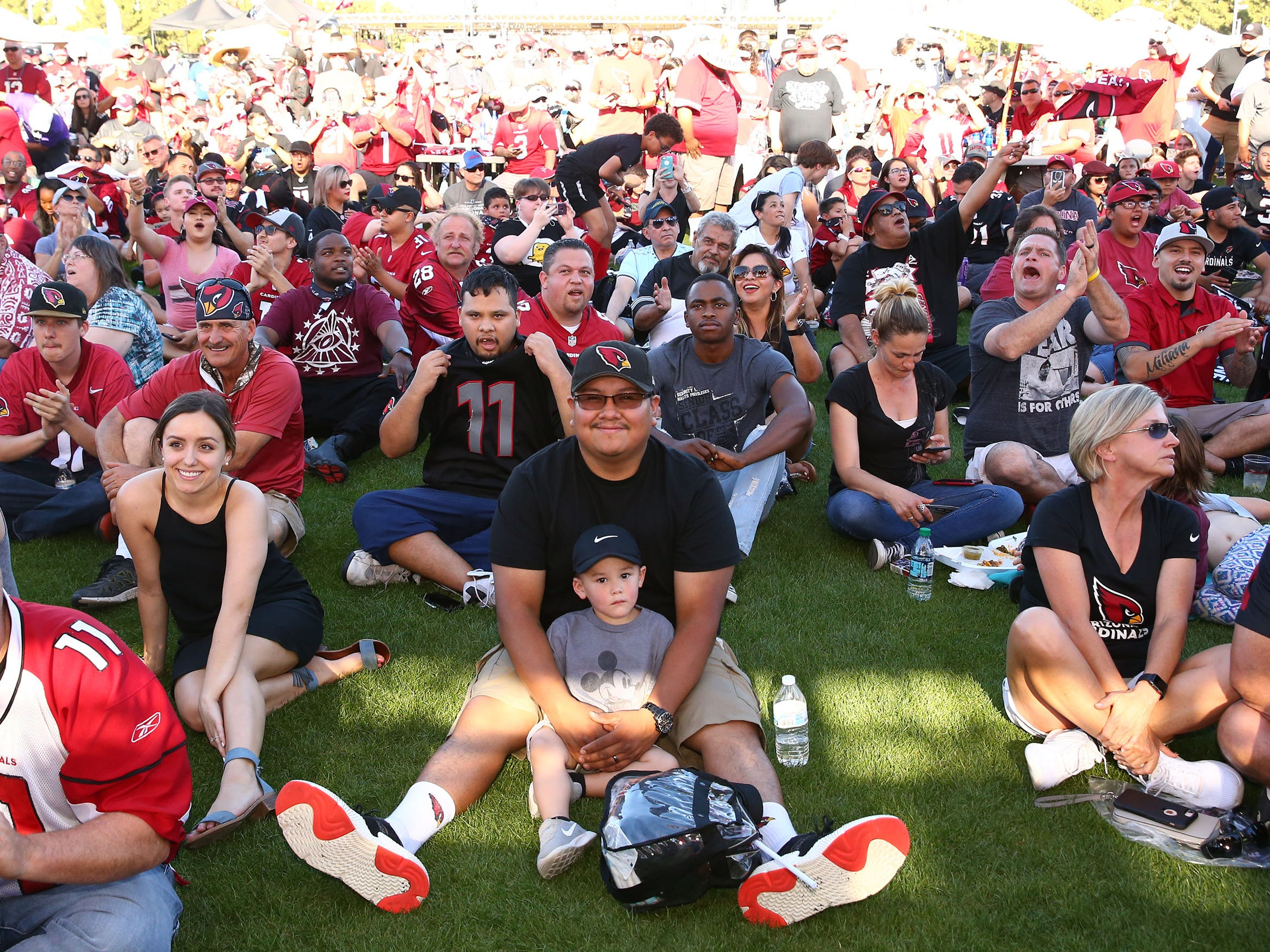Fans prepare for the annoucement of the number one draft pick by the Arizona Cardinals during the NFL Draft watch party at State Farm Stadium on Apr. 25, 2019 in Glendale, Ariz.