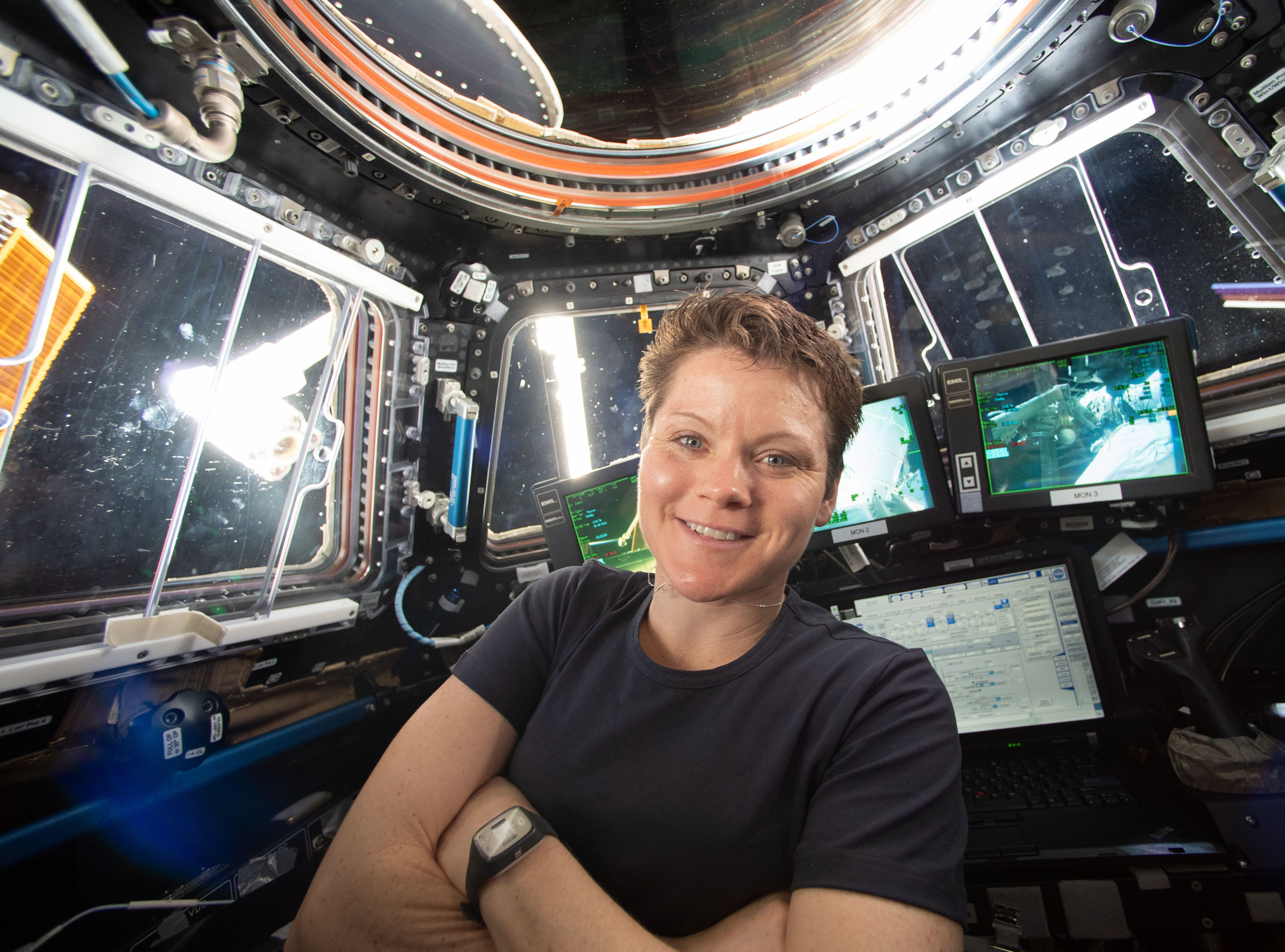 NASA astronaut Anne McClain takes a break for a portrait in April 2019 inside the cupola of the International Space Station while practicing Canadarm2 robotics maneuvers and Cygnus spacecraft capture techniques.