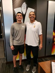 Trenton Bourguet stands with Arizona State football coach Herm Edwards during a visit.