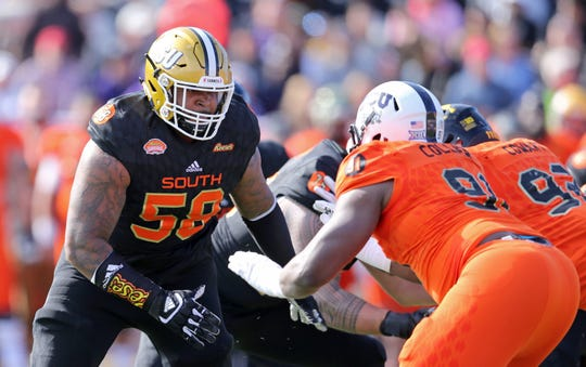 Alabama State tackle Tytus Howard (58), playing for the South team, gets set to block against the North team during the Senior Bowl at Ladd-Peebles Stadium.