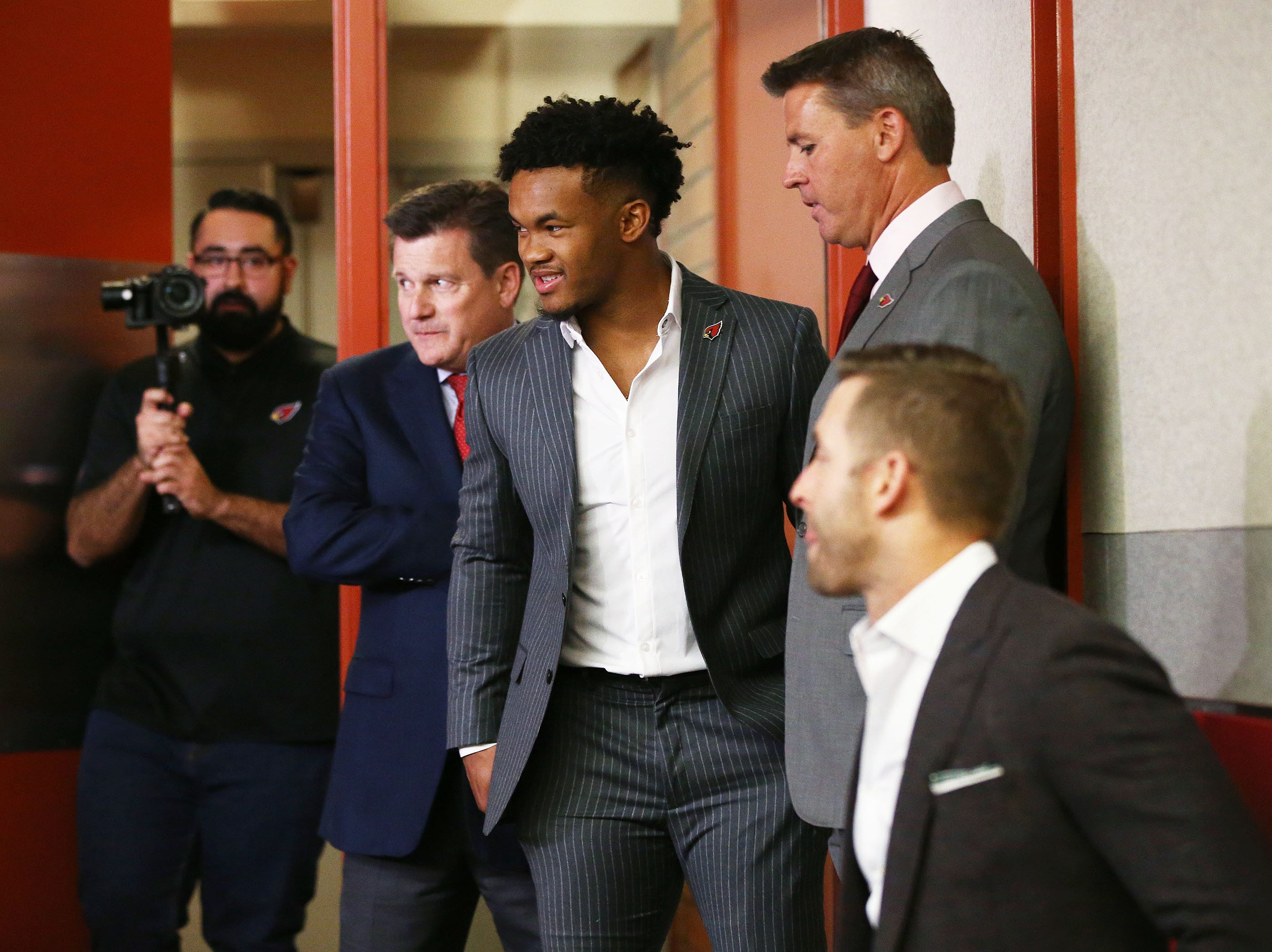 Kyler Murray arrives for his introductory news conference on April 26.