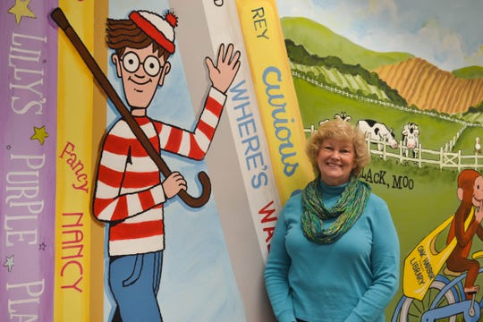 As Oak Harbor Public Library Board President, Kathy Steinmiller was instrumental in the library's initial construction, the creation of the  Local History and Museum Center in the library's lower level, and the children's department addition, where this colorful mural was recently painted.