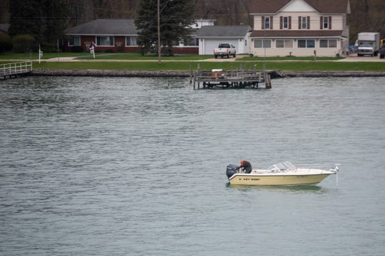 Fishing boats are seen on the St. Clair River near Algonac Thursday, April 25, 2019.