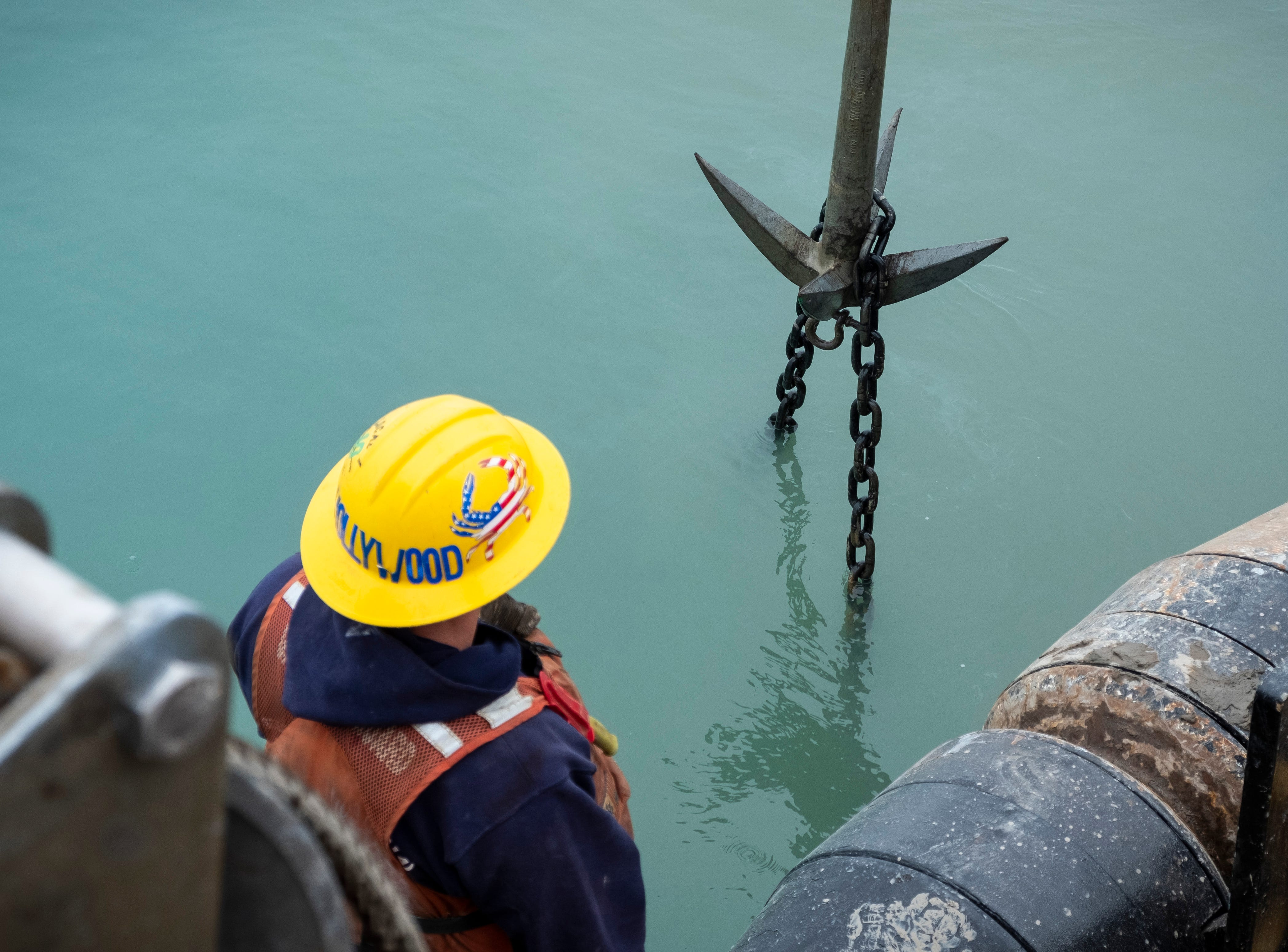 After some time, the grapple is lifted out of the water. On the crew's first attempt, it hooked onto the buoy's chain.