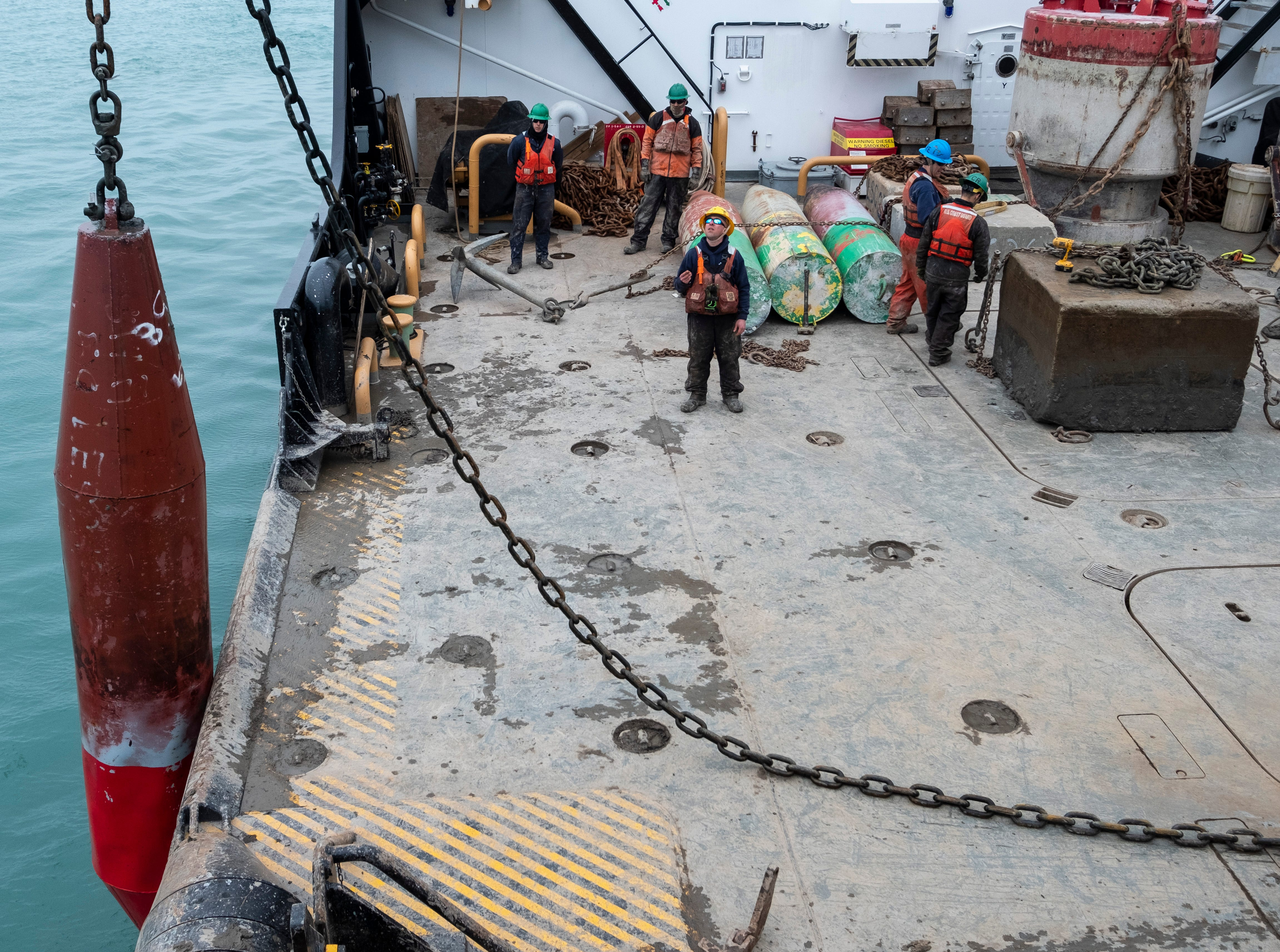 The sunken buoy is lifted out of the water and onto the Hollyhock's buoy deck. The cuase of the sinking was not immediately determined, although crewmembers said it could have been punctured from ice or a passing ship.