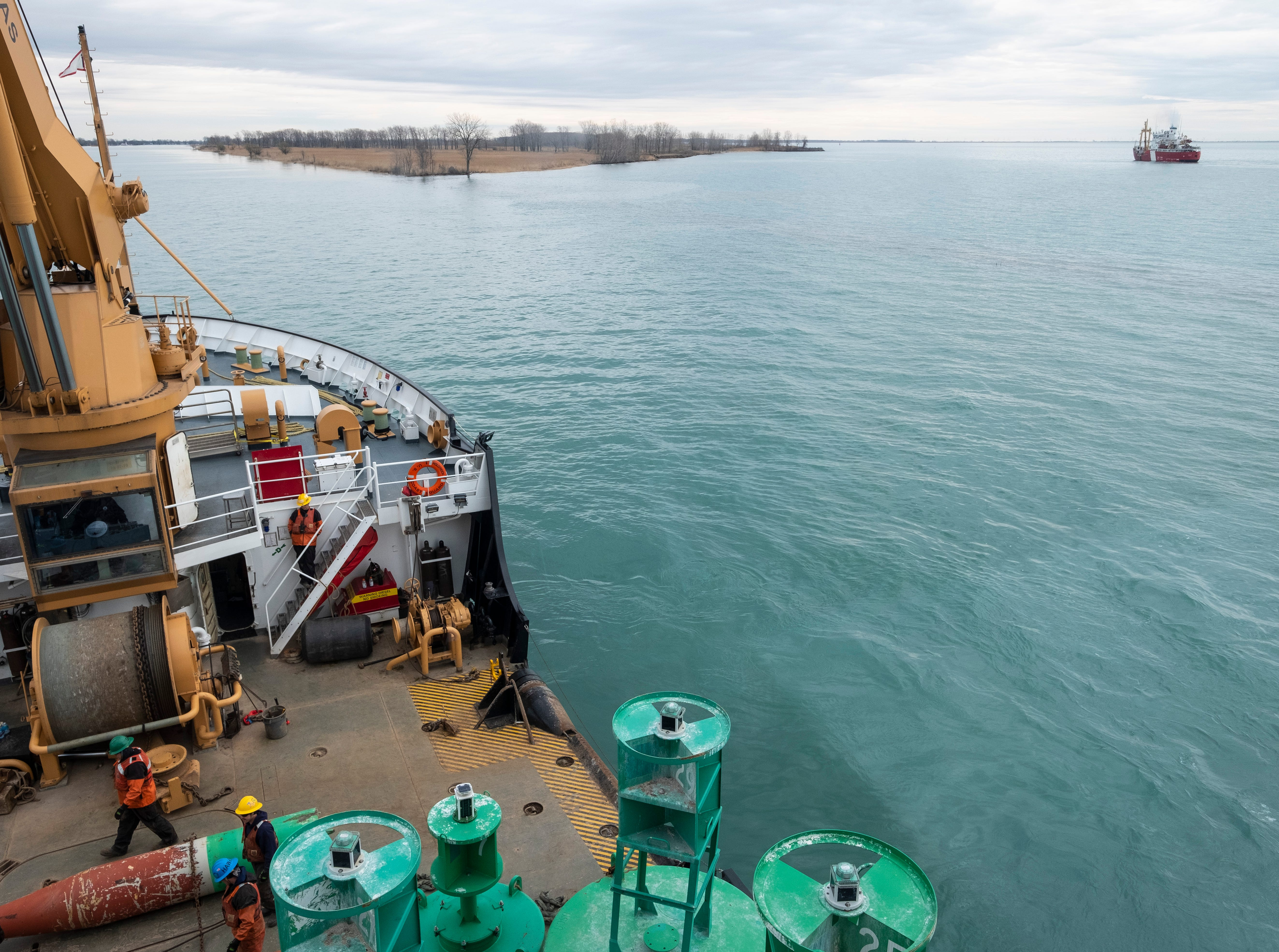 While the USCGC Hollyhock's crew works to remove a buoy from the St. Clair River, Canadian Coast Guard Ship Griffon and its crew work one of their buoys nearby.