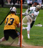 Chandler Hake scores a York Catholic goal in the first quarter against Red Lion, Thursday, April 25, 2019.