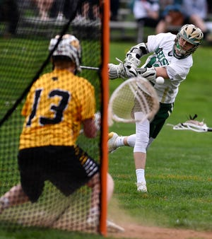 Chandler Hake, seen here at right in a file photo, had four goals on Tuesday in York Catholic's 10-9 overtime loss to Hershey.