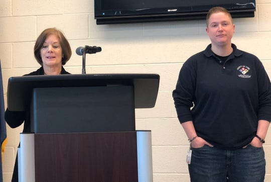 York County 911 dispatcher Katie Flynn (at right) was named the county's telecommunicator of the year at a ceremony on April 18, 2019. At left, York County Commissioner Susan Byrnes talks about Flynn's accomplishments.