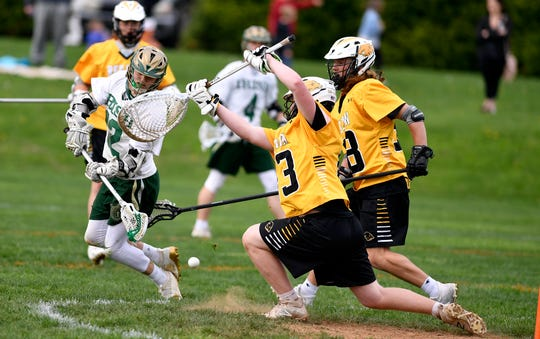 York Catholic's Chandler Hake takes a low shot past Red Lion goalkeeper Quinten Lyons, Thursday, April 25, 2019.