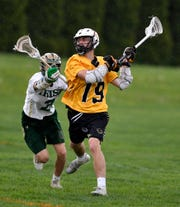 Ben Hornburger of Red Lion lines up for a shot on goal while covered by York Catholic's boy's Massimo Antolick, Thursday, April 25, 2019.