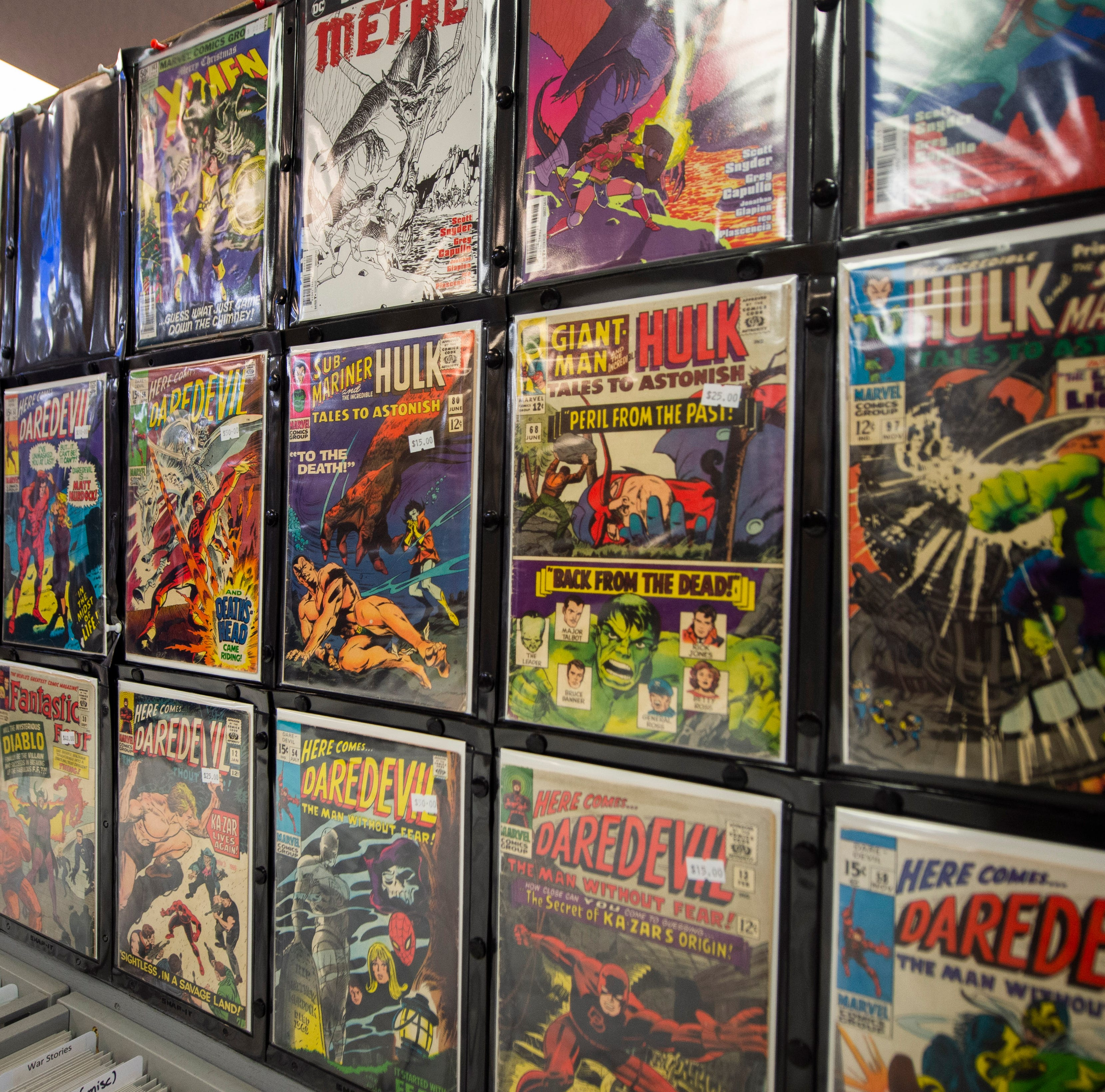 """A collection of Silver Age and Bronze Age comics on display inside Comic Store West in York. The store has seen an increase in customers with the release of """"Avengers: Infinity War"""" and """"Avengers: Endgame"""""""