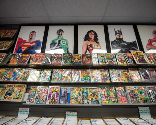 A row of Silver and Bronze Age comics inside Comix Collection in York.
