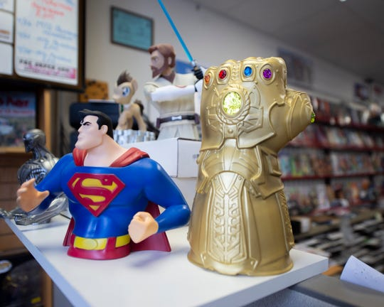 A toy replica of the Infinity Gauntlet inside Comic Store West.