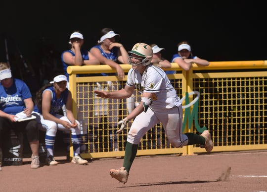 Manogue's Hailey Merlino celebrates a home run against McQueen during Tuesday's game at Bishop Manogue.