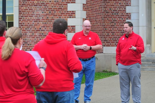 Richmond Community Schools Superintendent Todd Terrill speaks to Richmond High School teachers, staff members and students gathered for a walk-in Friday morning.