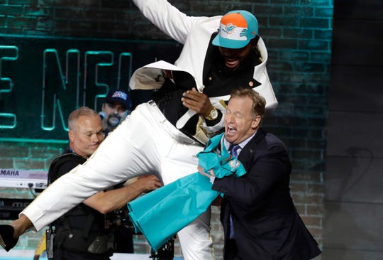 Christian Wilkins bumps NFL Commissioner Roger Goodell after the Miami Dolphins selected Wilkins in the first round of the 2019 draft in Nashville on Thursday.