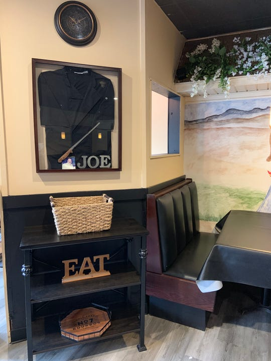 """A shirt and favorite knife of The Garlic Pit's founder Giuseppe """"Joe"""" Morelli is displayed on the wall. Morelli died in December 2018. His daughter reopened the eatery in April 2019."""