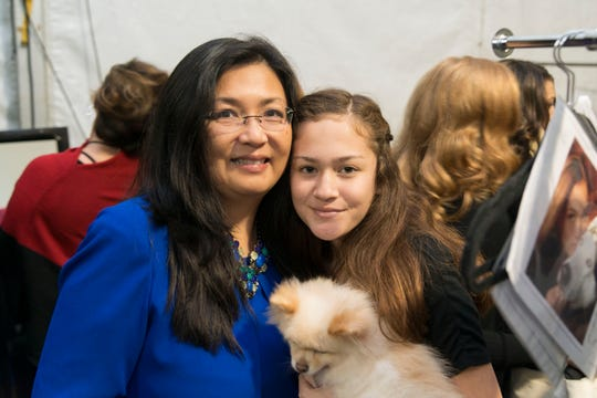 Mary Chao with daughter Noelle at Rochester's Fashion Week with Princess the Pomeranian