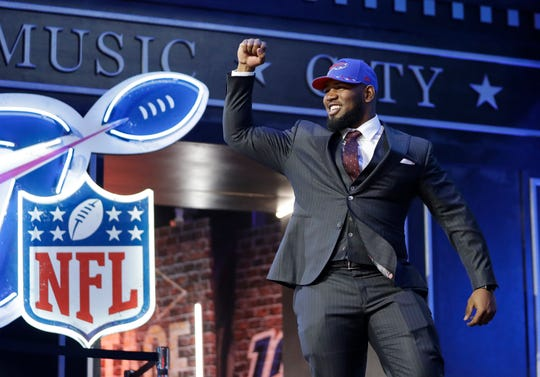 Houston defensive tackle Ed Oliver takes the stage after the Buffalo Bills selected him in the first round at the NFL football draft, Thursday in Nashville.