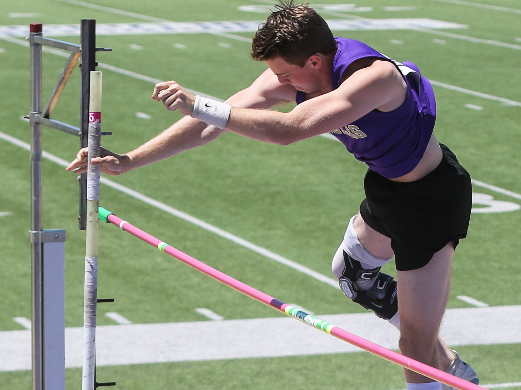 Sterling City's Guy Caldwell clears the bar during the boys pole vault during the Region II-1A championships Friday, April 26, 2019, at Angelo State University.