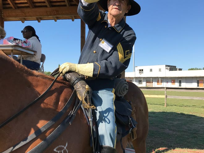 Ron Perry, 1st sergeant for Company D of Fort Concho, points out the stables at the Regional Cavalry Competition at Fort Concho, 630 S. Oakes St. on Friday, April 26, 2019.