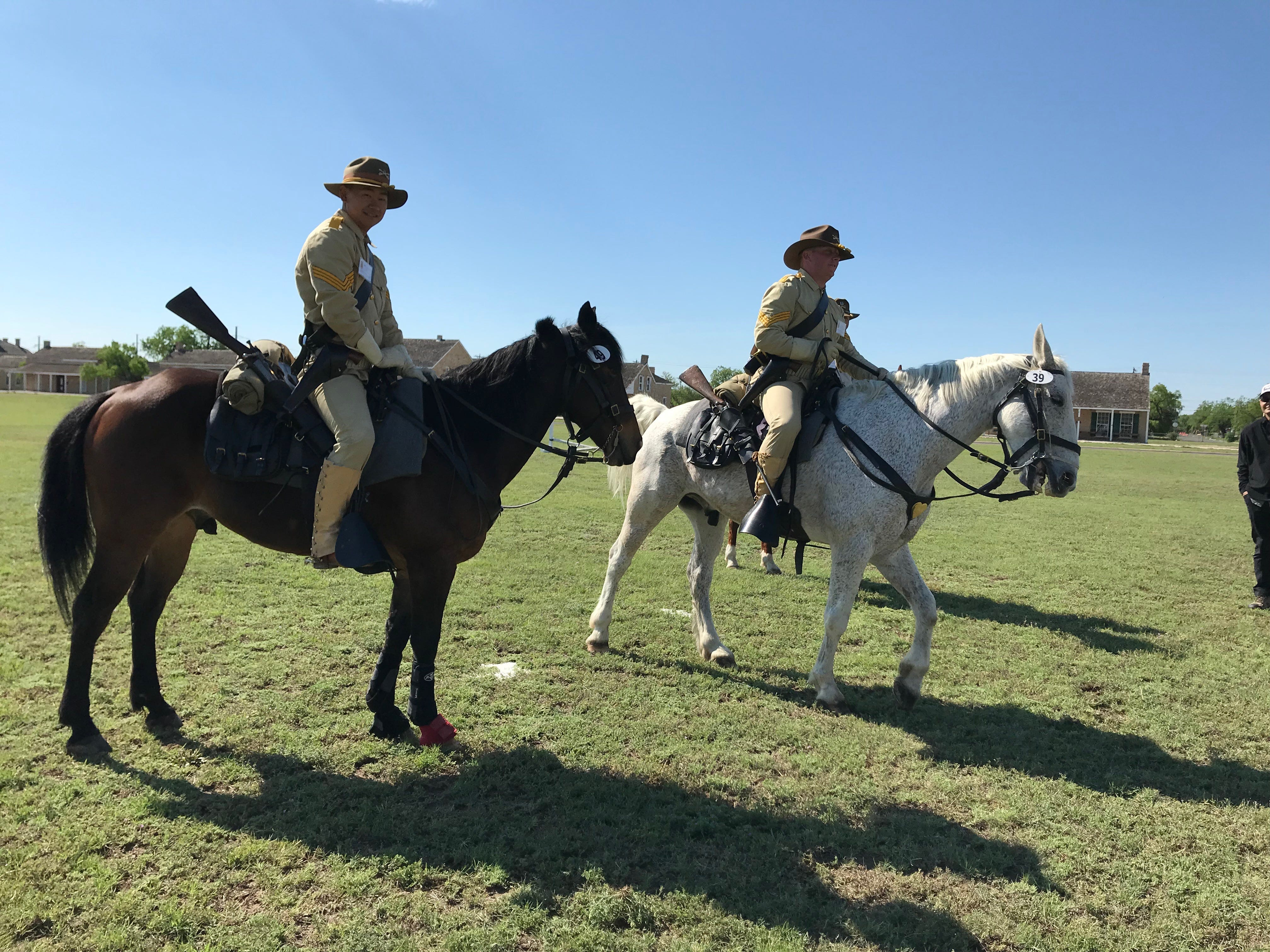 Two riders rest for a moment. whether their horses agree or not, at the Regional Cavalry Competition at Fort Concho, 630 S. Oakes St. on Friday, April 26, 2019.