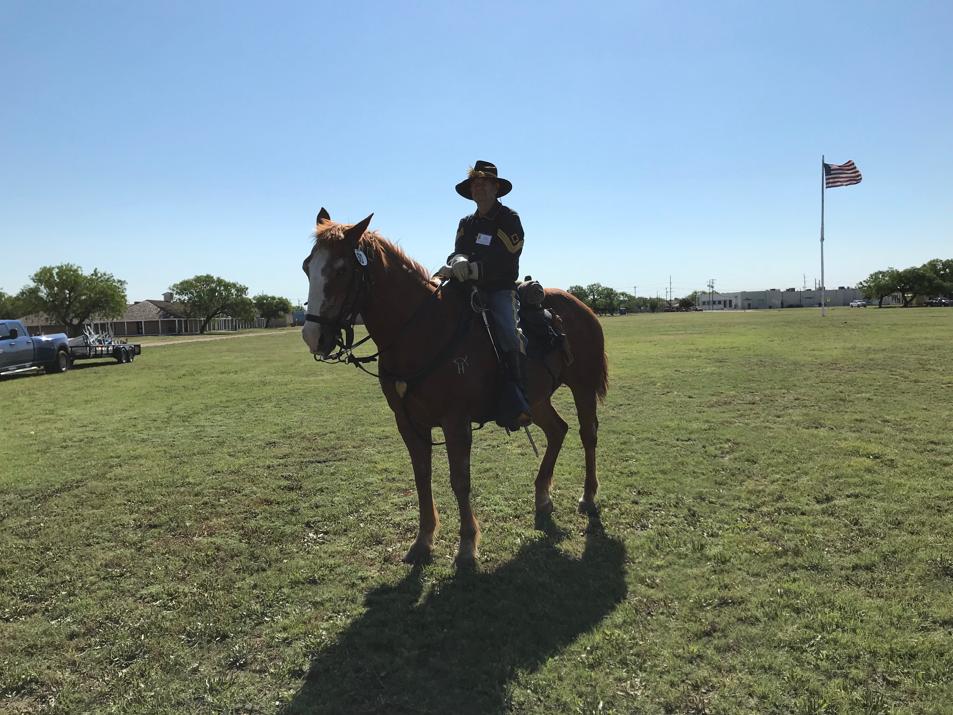 Ron Perry, 1st sergeant of Fort Concho's Company D, and Rooster, pause at the Regional Cavalry Competition at Fort Concho, 630 S. Oakes St. on Friday, April 26, 2019.