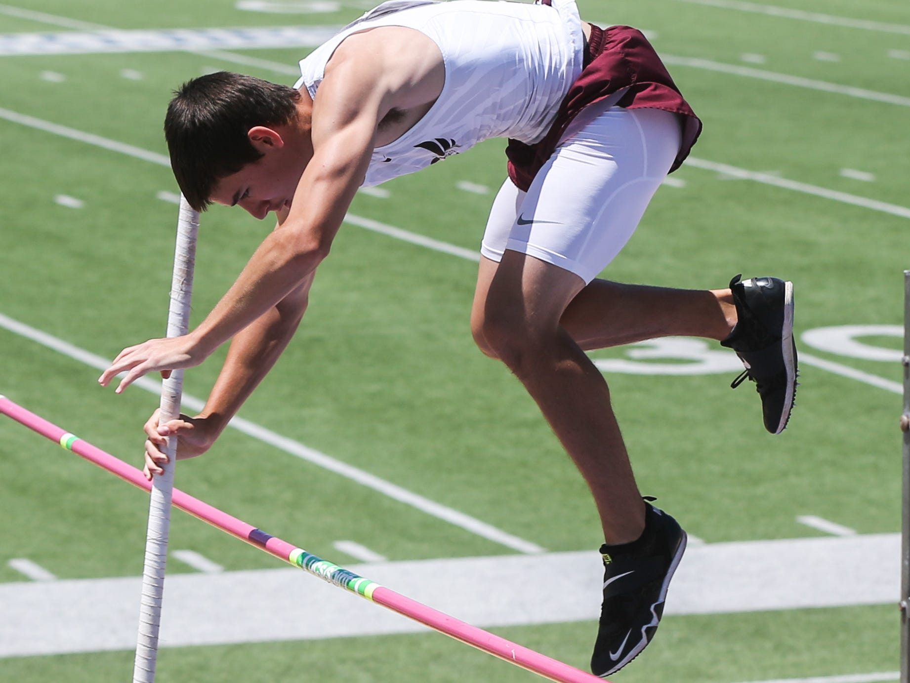 Rankin Harrison Fouts jumps the pole vault during the Region II-1A championships Friday, April 26, 2019, at Angelo State University.