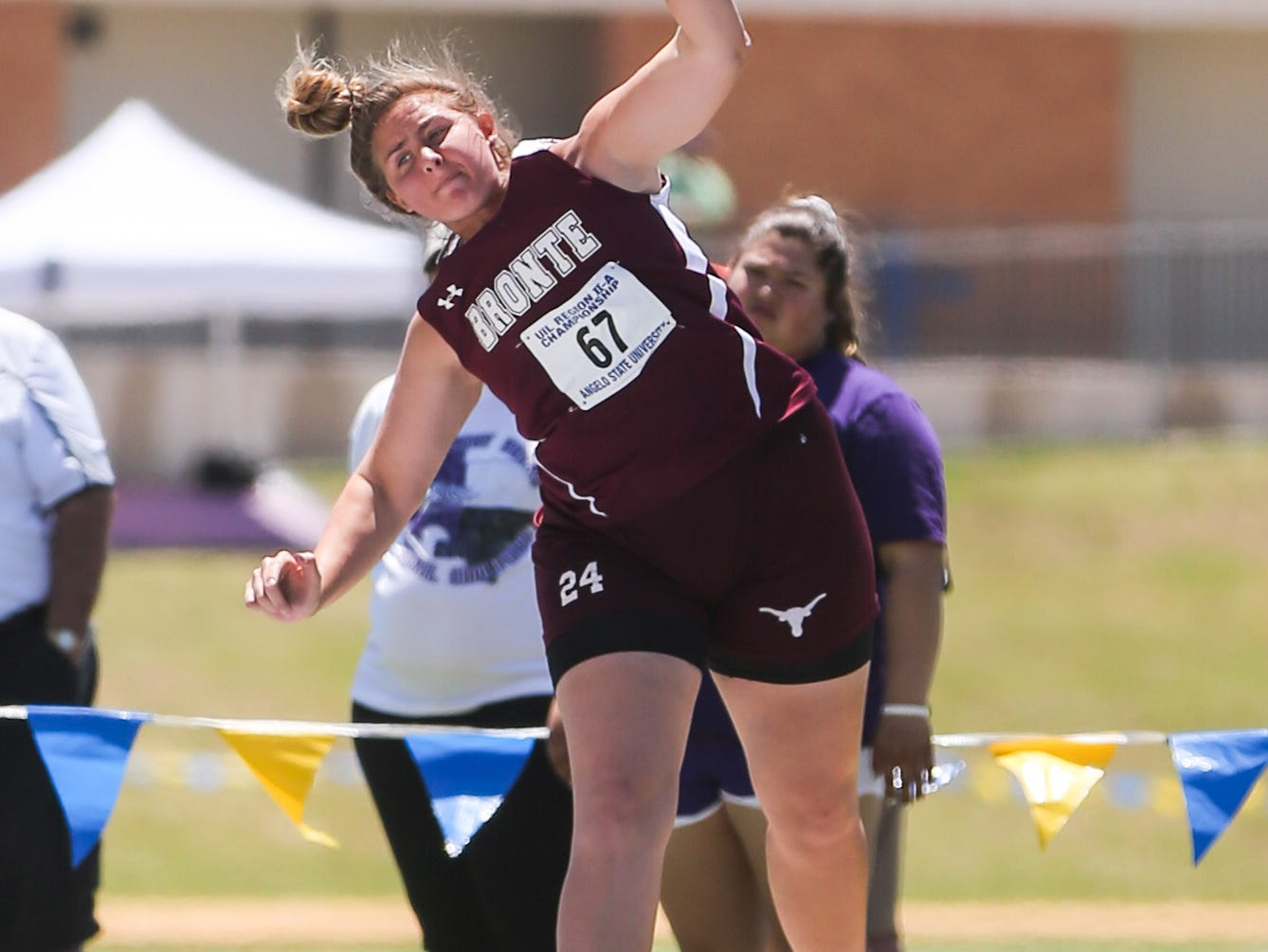 Bronte's Kristen Stilley throws a shot put during the Region II-1A championships Friday, April 26, 2019, at Angelo State University.