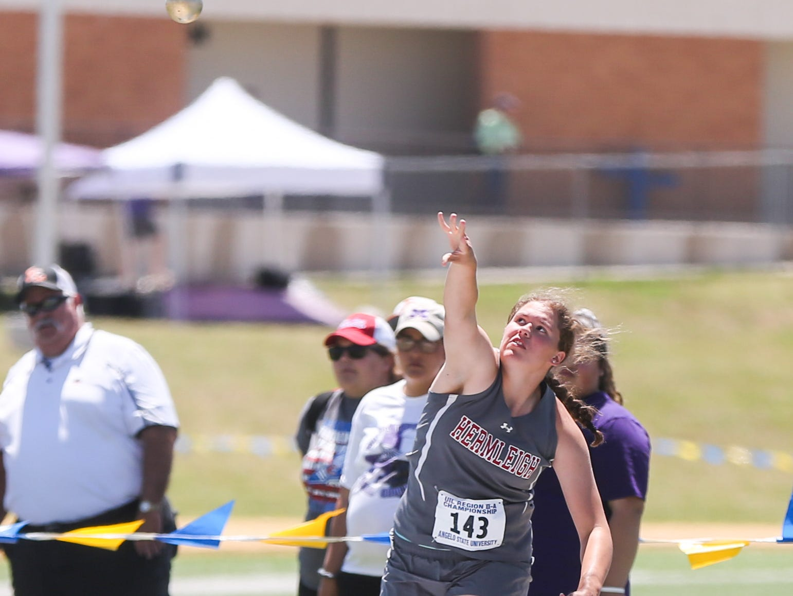 Hermleigh's Kiki Gonzales throws a shot put during the Region II-1A championships Friday, April 26, 2019, at Angelo State University.