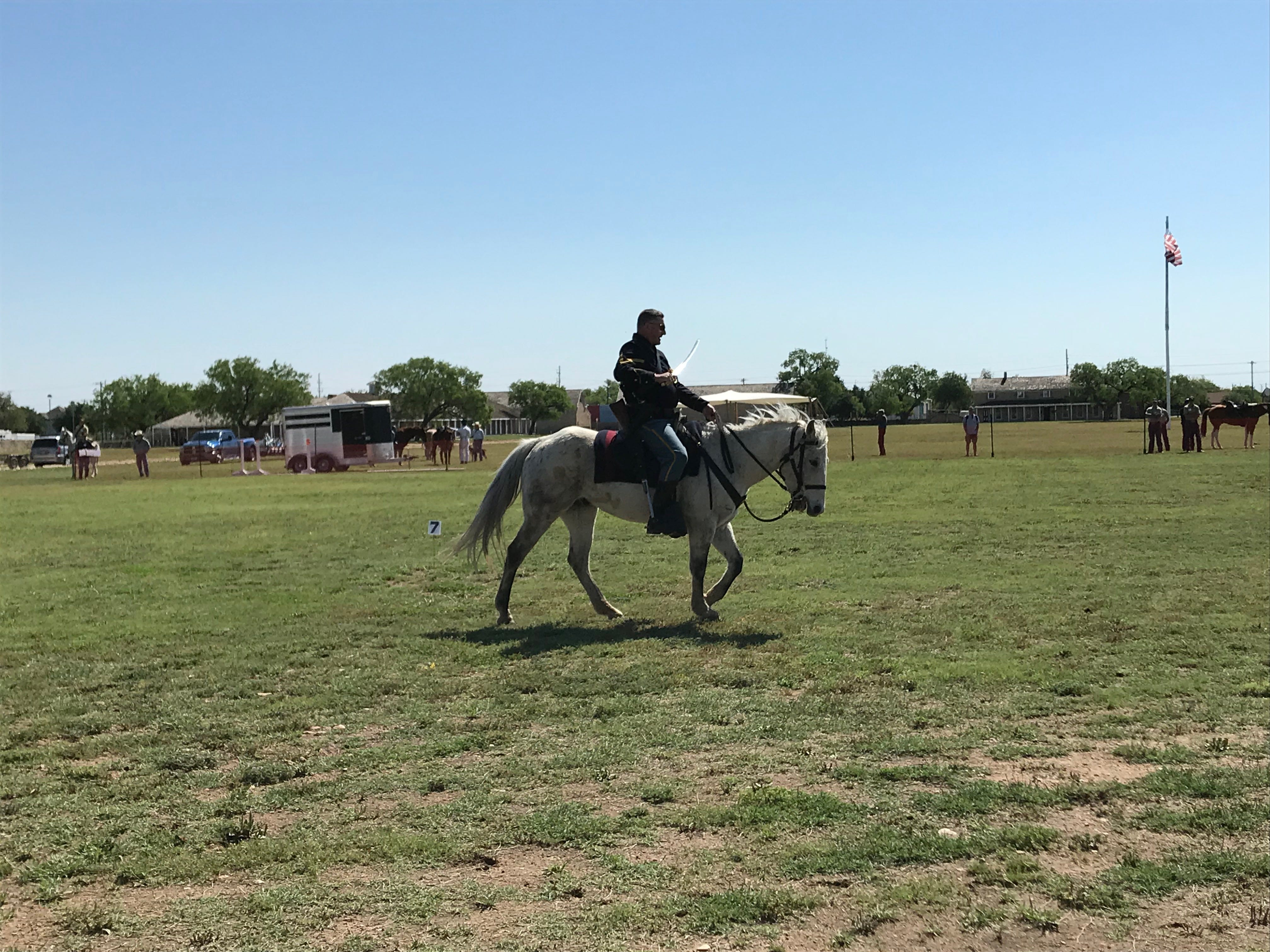 This rider flashes a saber at the Regional Cavalry Competition at Fort Concho, 630 S. Oakes St. on Friday, April 26, 2019.