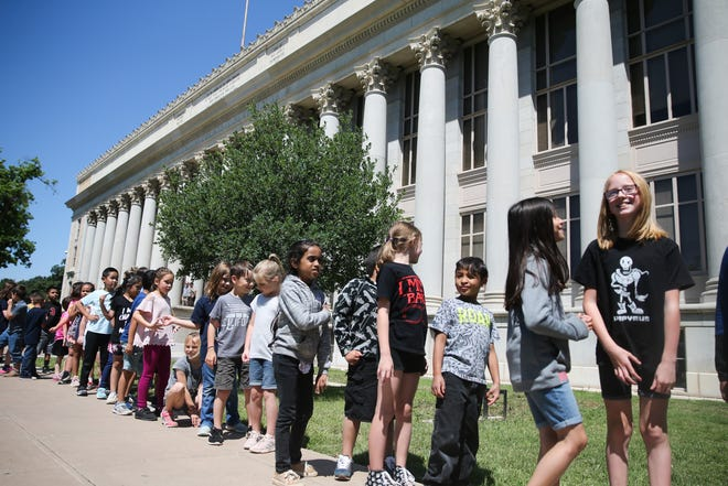 Students march around the courthouse during the Read to Me event Friday, April 26, 2019, at the Tom Green County Courthouse.